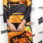 Heidi Klum flash some pins in this dragon print dress