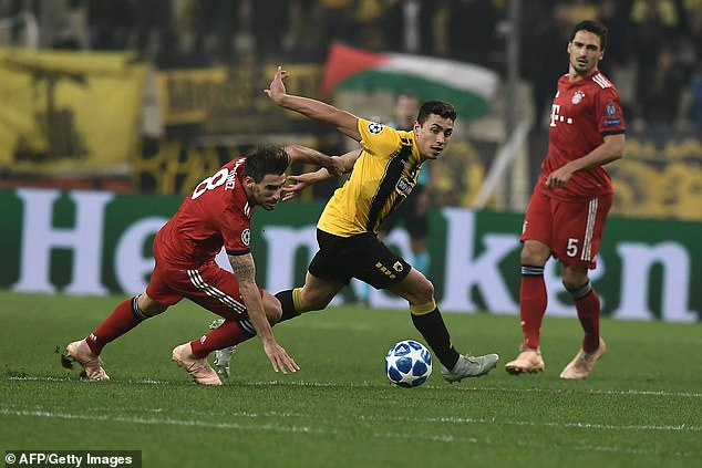 AEK Athens forward Ezequiel Ponce looks to spin away from defender Mats Hummels