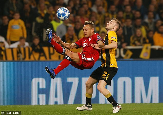 Bayern Munich defender Rafinha shows off his agility in an attempt to clear the ball