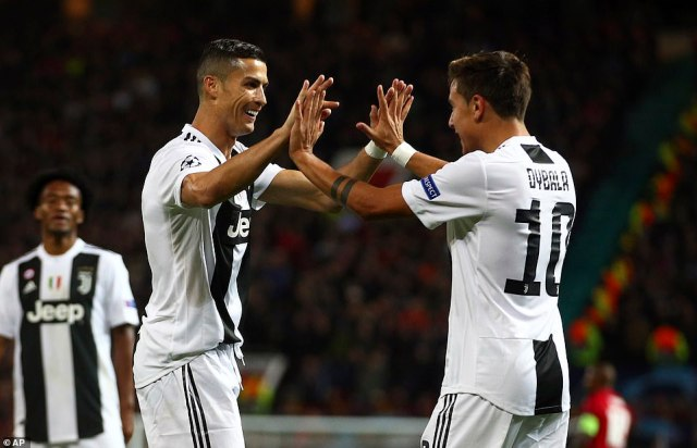 Cristiano Ronaldo celebrates with Dybala on his return to Manchester United as a Juventus player on Tuesday night
