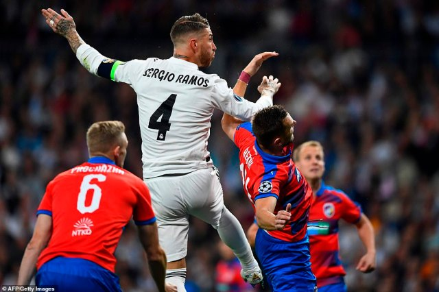 Sergio Ramos powers a header towards goal as Real Madrid look to bounce back from defeat at home by Levante