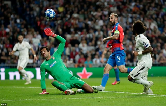 Marcelo lifts the ball over the hapless Viktoria Plzen goalkeeperAles Hruska to double Real Madrid's lead after half time