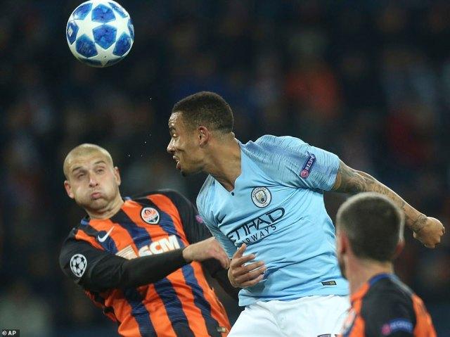 Manchester City's Gabriel Jesus  challenges for the ball in the air withShakhtar Donetsk'sYaroslav Rakitskiy
