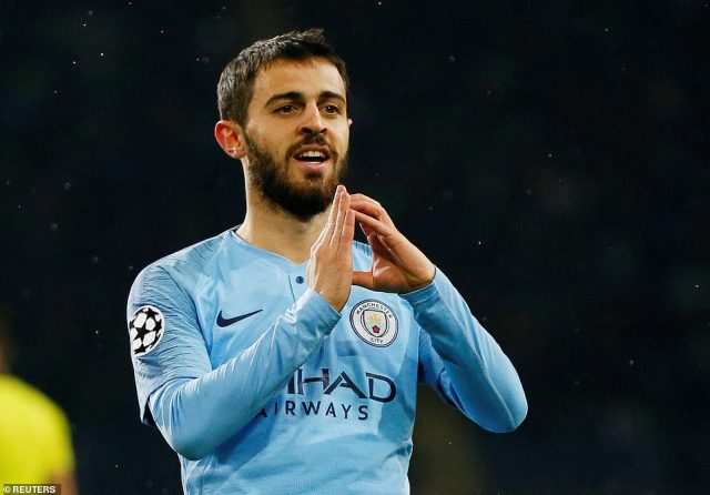 Silva celebrates after putting Manchester City 3-0 up againstShakhtar Donetsk in the Champions League on Tuesday night