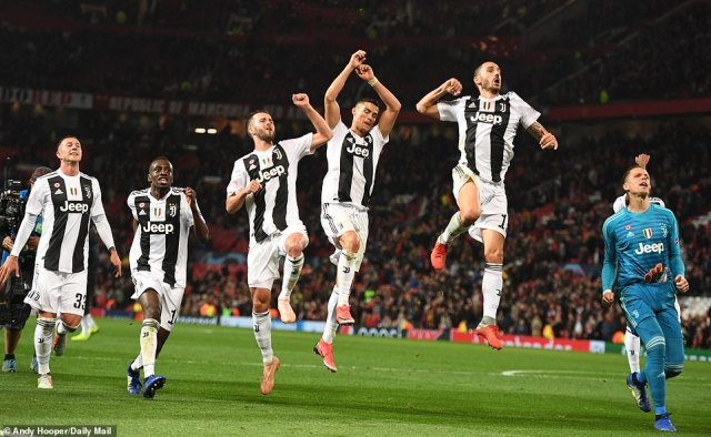 Ecstatic Juventus players jump for joy after the final whistle confirmed their victory over Manchester United