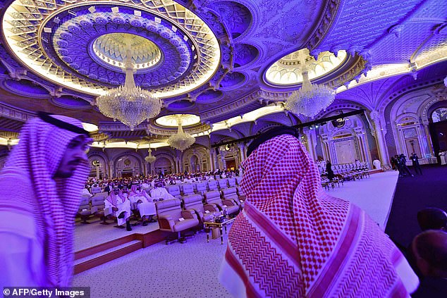 The Crown Prince is set to address the Future Investment Initiative summit in Riyadh on Wednesday afternoon. Pictured: summit participants arrive at the event in Riyadh