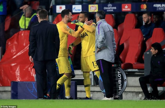 Keeper Lloris offered some words of encouragement to No 13 Michel Vorm who replaced him in goal for the closing stages
