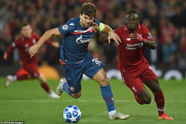 Red Star Belgrade defender Filip Stojkovic vies with Liverpool forward Mane at Anfield on Wednesday evening