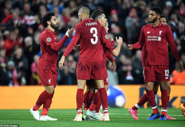 Mohamed Salah is surrounded by his Liverpool team-mates to celebrate with him after he scored at the end of the first half