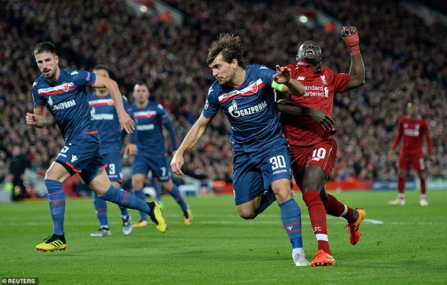 Red Star Belgrade's Filip Stojkovic fouls Liverpool's Mane to give away a penalty in the second half of the match at Anfield
