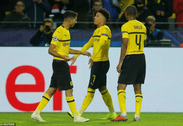 English teenager Jadon Sancho (centre) scored his first ever Champions League goal as Dortmund thrashed Atletico Madrid