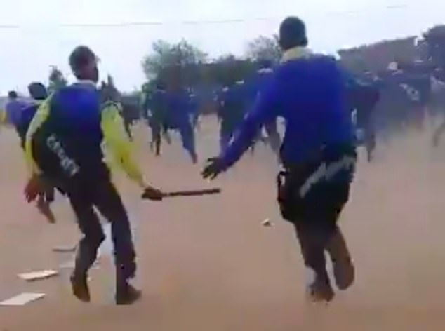 Dozens of fellow pupils can be seen running away as if for their lives and many schoolgirls can be heard screaming hysterically as those armed with the pangas give chase