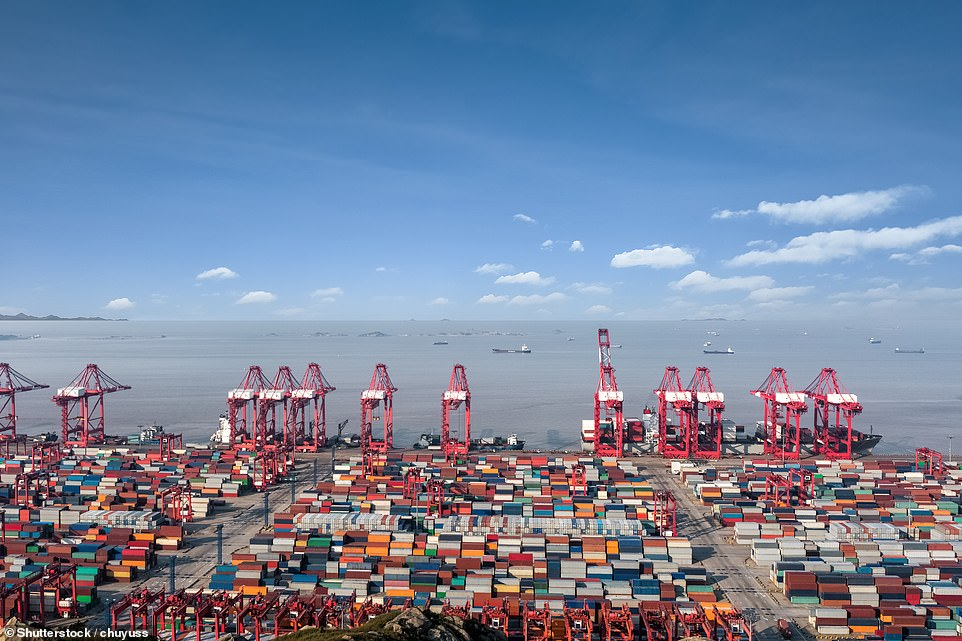 Shipping containers are ready to be loaded at the Shanghai International Shipping Center. The port of Shanghai is the busiest port in the world in terms of cargo tonnage carried