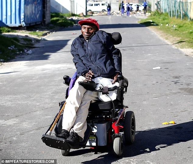 Mr Mciki relies on an electric wheelchair to get around now because his hips and legs have almost completely seized up – though he was able to walk without assistance until he was around 40 years old