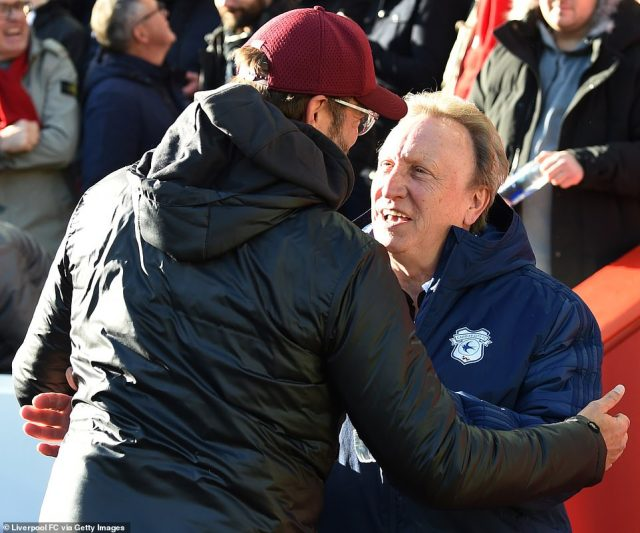 Jurgen Klopp and Neil Warnock embrace on the touchline ahead of kick-off at Anfield between Liverpool and Cardiff