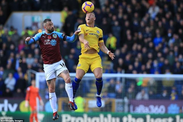 Barkley vies with Burnley's Belgian midfielder Steven Defour in an aerial duel during the opening exchanges of the contest