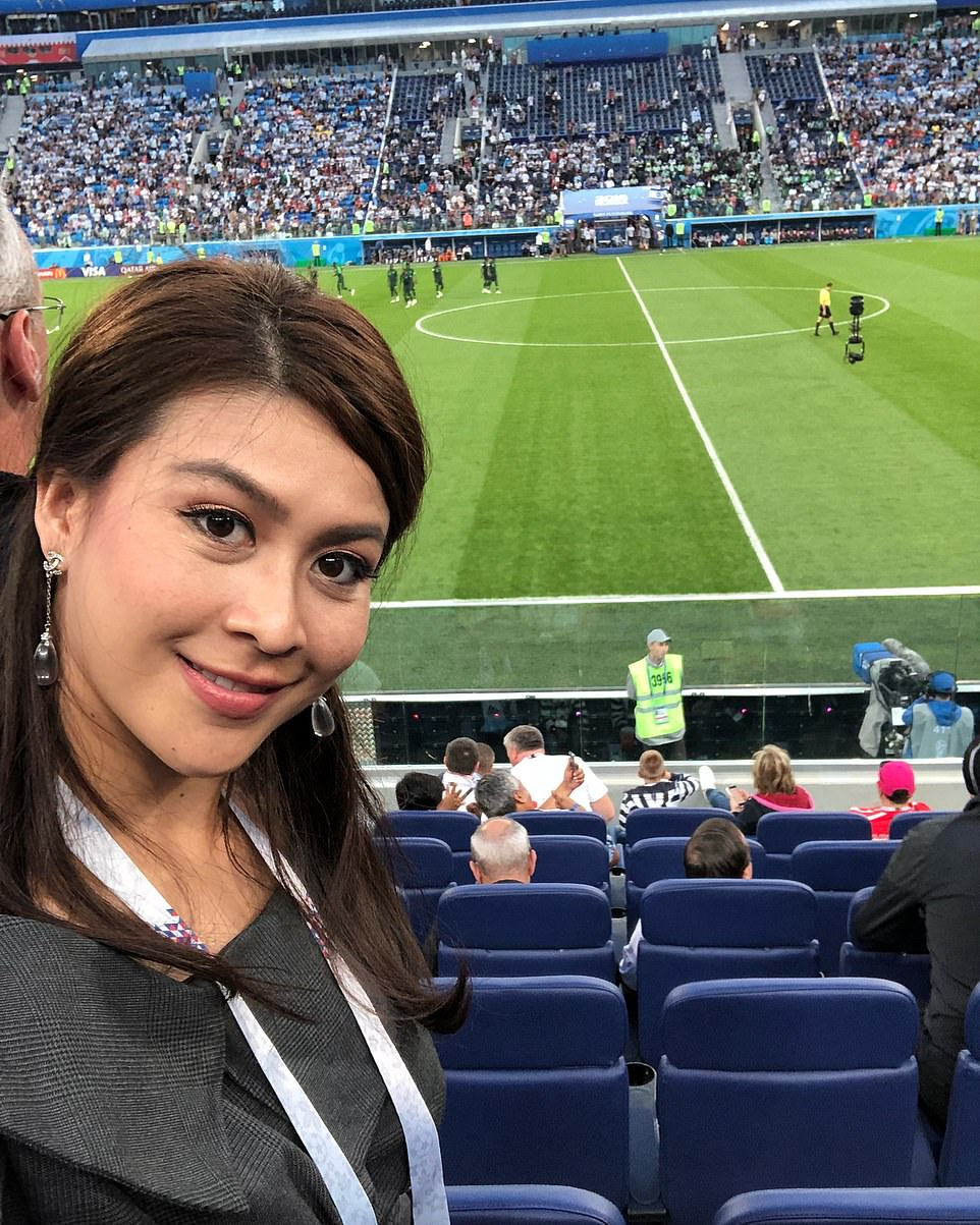 Tragic Ms Suknamai takes a selfie at a football game. She worked for Leicester City FC owner Vichai Srivaddhanaprabha