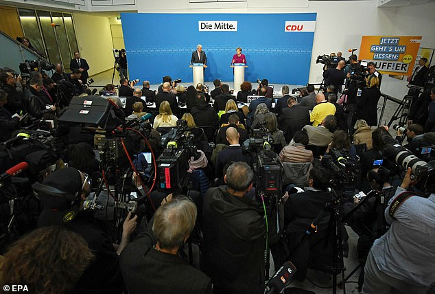 Merkel announced her decision alongside Volker Bouffier, the Prime Minister of Hesse, after a her CDU party took a beating at the polls in the state