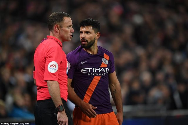 City's Argentine striker talks with a match official after a foul is given against Tottenham during the opening stages