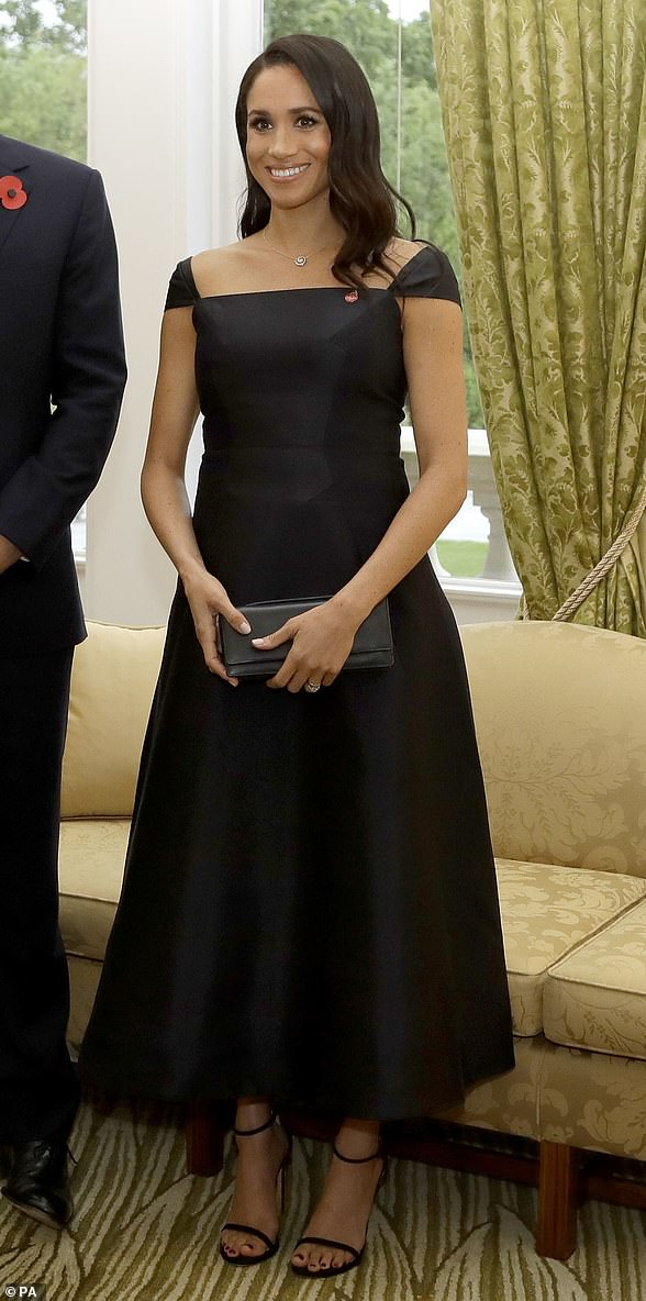 8c7631c32 For her speech at Government House, Meghan wore a navy cocktail dress by  New York