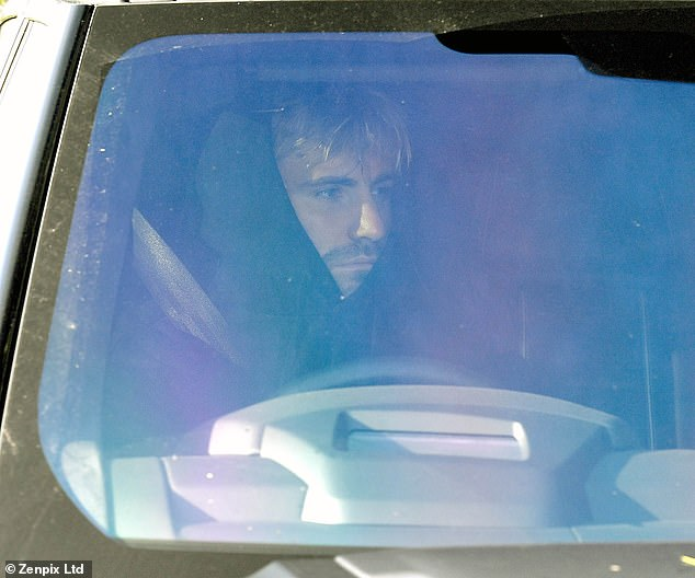 Luke Shaw, with a hood tightly wrapped around his face, what another braced for the cold
