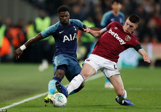 Serge Aurier (left) and Declan Rice (right) battle for possession as Spurs attack down the wings at the London Stadium