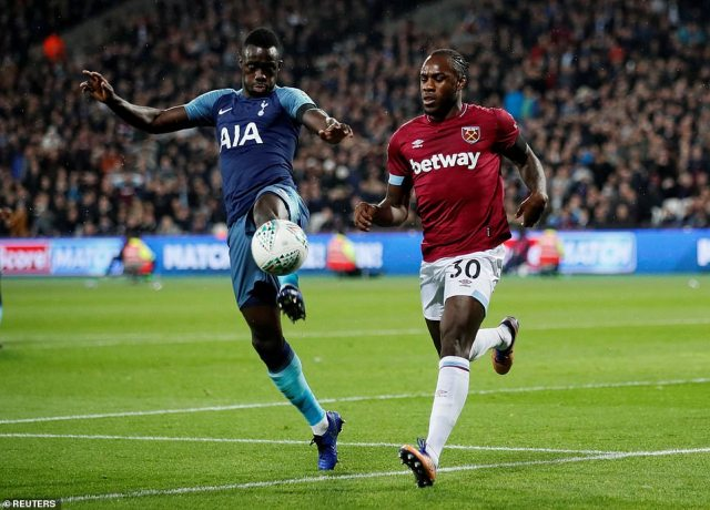Davinson Sanchez (left) and Michail Antonio (right) battle for possession during an action-packed first half in east London