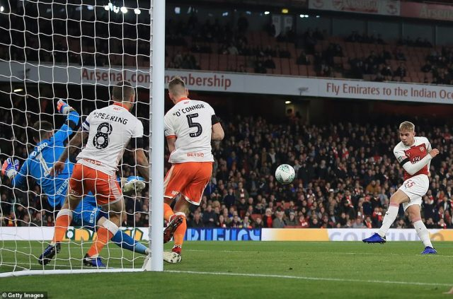 Arsenal's No 55 failed to hit his shot cleanly but still found the roof of the net to give his side a two-goal advantage