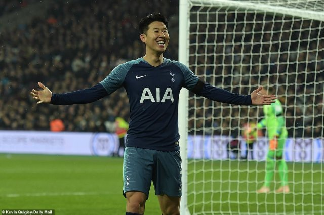 A smiling Son Heung-Min celebrates with the Tottenham fans after putting his side 2-0 up in the second half on Wednesday
