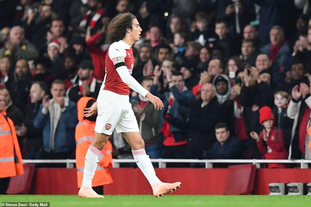 Guendouzi looks dejected as he walks off the pitch after being sent off for a second bookable offence in the 57th minute