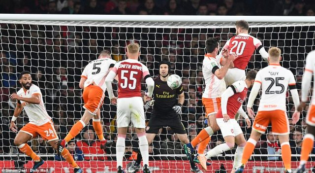 Blackpool's Paudie O'Conner (No 5) scores with a header from a corner to fire his club back into the Carabao Cup fixture
