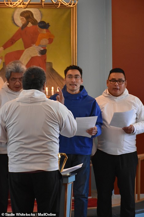 Aleqatsiaq Peary sings in the men's choir