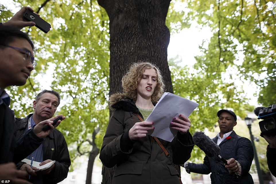 AGoogle employee reads from a list of accounts from other employees during a walkout in Toronto on Thursday