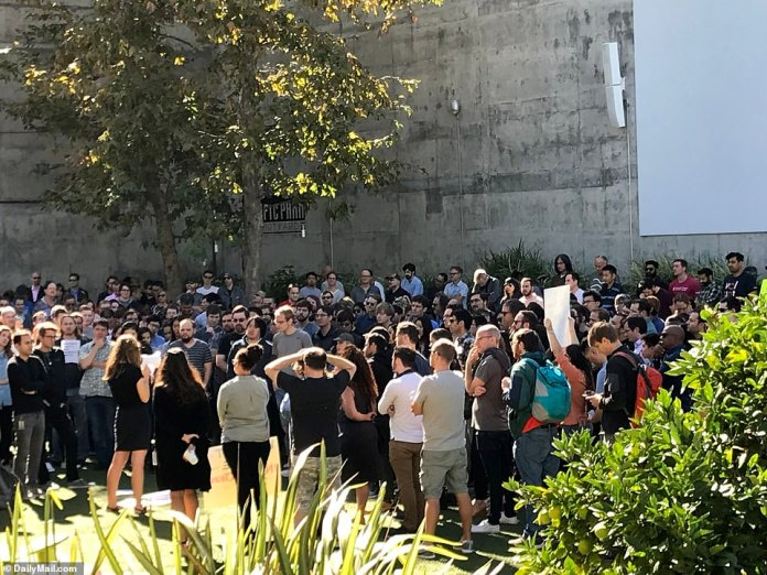 An employee at the microphone spoke to the crowd and encouraged those who wanted to do their turn to talk at the Google office in Venice, California