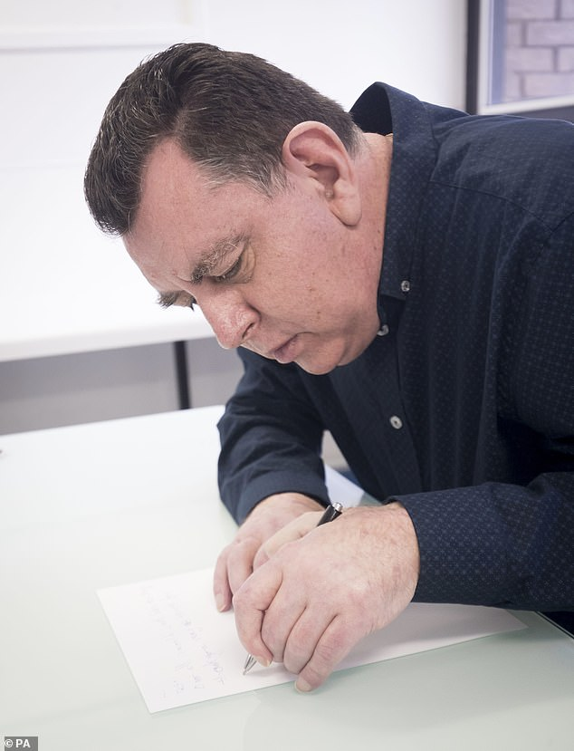 In the weeks following the 12-hour procedure, he was able to pour a pint of his favourite Yorkshire ale from a bottle (pictured writing a letter)