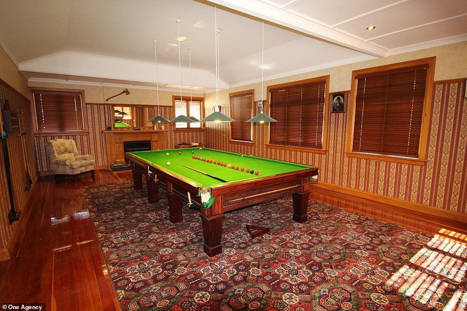 The billiard room in the main house in the village. Strict property laws in New Zealand mean that only indigenous kiwis can buy the village