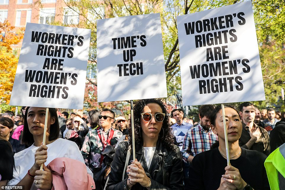 Workers set up signs in front of Google's offices on 14th Park Street in New York yesterday as demonstrations took place in different time zones in their worldwide offices