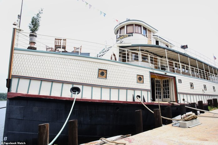 An exterior view of the Yankee four storey floating mansion in New York. The ship served as an upscale New England ferry, a harbor patrol boat in Boston, a troop transport ship, and a ferry to Ellis and Liberty Islands, before being converted into a home