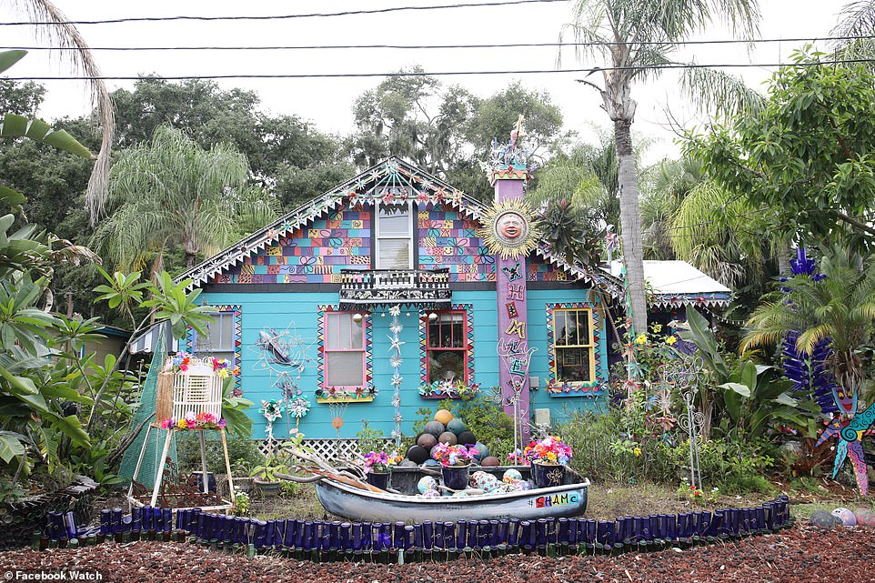 Another view of the colorful Whimzey house with blue glass bottles