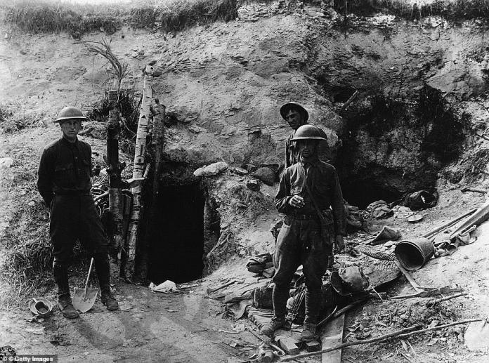 """This picture shows an opening to one of the tunnels in northern France, with American soldiers standing outside the prison. All of their recruits from the 26th Division came from New England, so they got the nickname """"Yankees,"""" which describes someone from the state"""