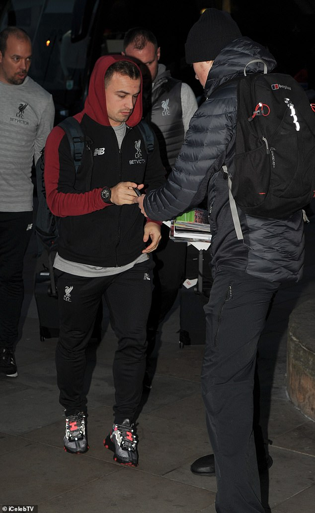 The in-form Xherdan Shaqiri stopped to sign autographs for fans who had gathered at the station