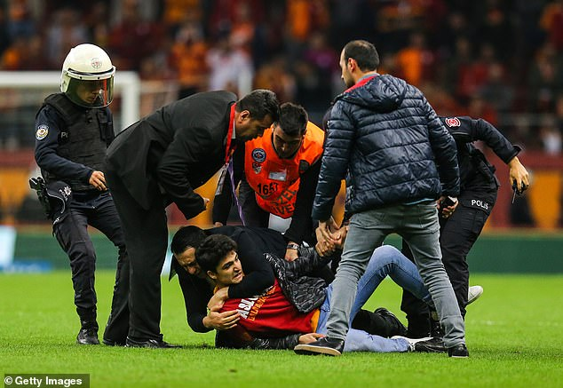 A supporter made it onto the pitch but what tackles the ground by police and stewards