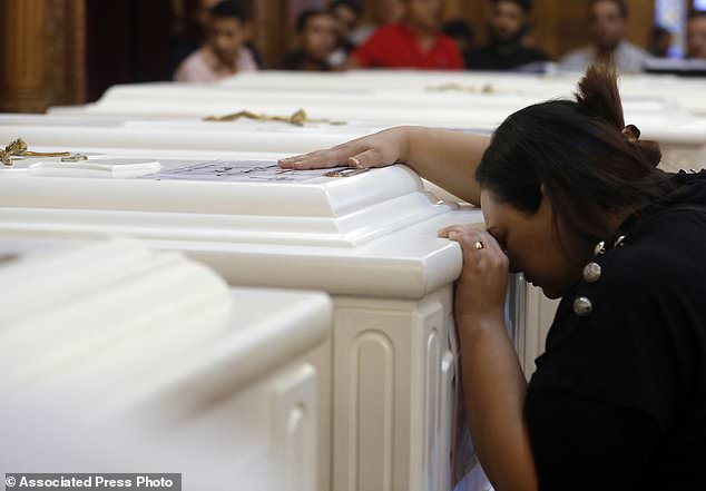 A relative of a dead Christian mourns during the funeral service in the Church of the Great Martyr Prince Tadros in Minya (Egypt) on Saturday, November 3, 2018. Coptic Christians in the Egyptian city of Minya were preparing to bury their dead one day After militants ambushed Three buses carrying Christian pilgrims on their way to a remote desert monastery killed seven and wounded 19th (AP Photo / Amr Nabil)