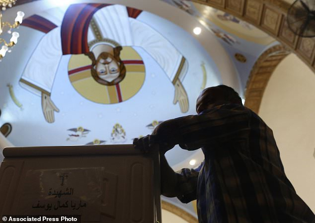 A relative of a murdered Coptic Christian grieves during a funeral in the church of the Great Martyr Prince Tadros in Minya Minya on Saturday, November 3, 2018. Coptic Christians in the Egyptian city of Minya were preparing to send their dead one day after the fighters Buried three buses of Christian pilgrims on the way to a remote desert monastery. (AP Photo / Amr Nabil)