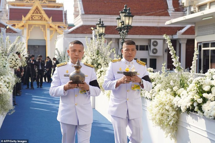 Royal officials meet with offerings at the Wat Thepsirin Buddhist Temple in Bangkok for Srivaddhanaprabha's funeral
