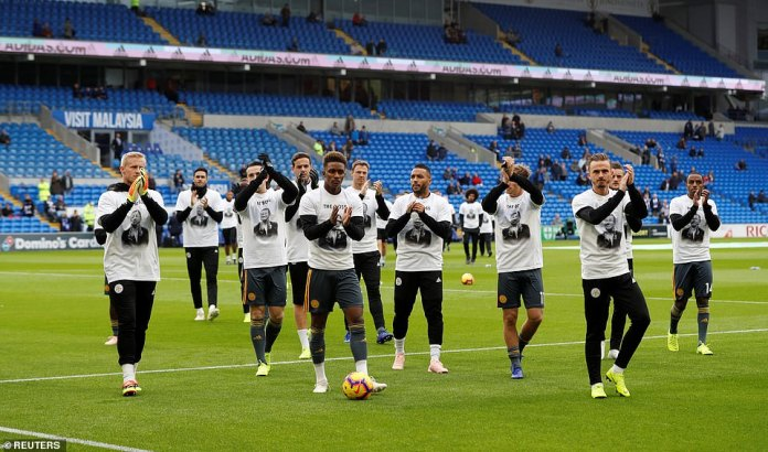 The crew of Leicester shows a united front as they applaud their traveling supporters with the special tribute shirts