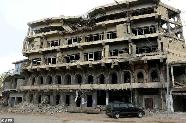 This Mosul building that formerly belonged to a bank was heavily damaged during the occupation of Iraq's second city by the Islamic State group and an extended military campaign by security forces to dislodge the jihadists