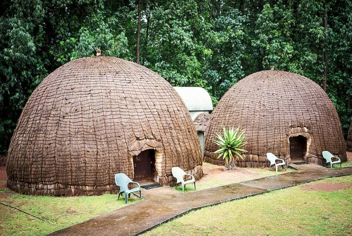 Dome from home: Grass and mud huts at the Mlilwane Wildlife Sanctuary, a four-hour drive from Johannesburg