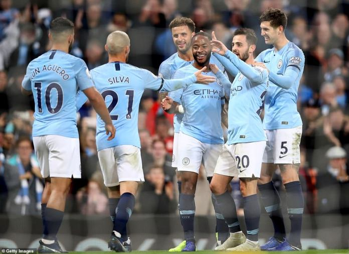The city players celebrate with Raheem Sterling after his second goal extended their lead to 5-1 against Southampton
