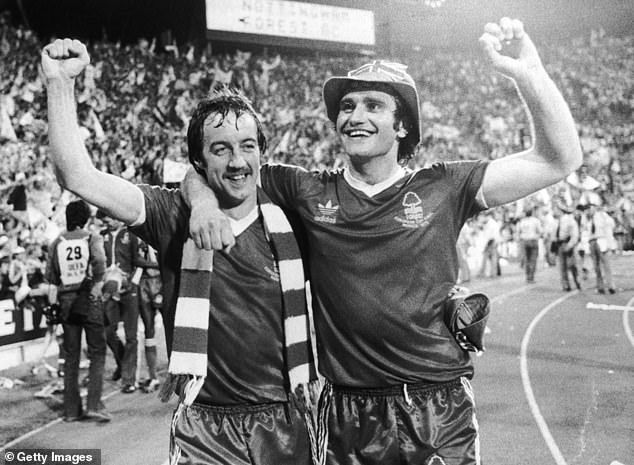 Frank Clark (L) and Larry Lloyd celebrate the victory of Nottingham Forest in the European Cup final